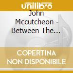 John Mccutcheon - Between The Eclipse cd musicale di Mccutcheon John
