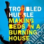 Making beds in a burning cd musicale di Hubble Troubled
