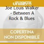 BETWEEN A ROCK & BLUES                    cd musicale di WALKER JOE LOUIS